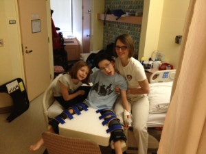 Deane, sister and I sitting on the edge of the bed - one of the things Deane misses since the surgery