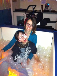 Chilling in the ball pit that is lit from below in the Snoozelen room