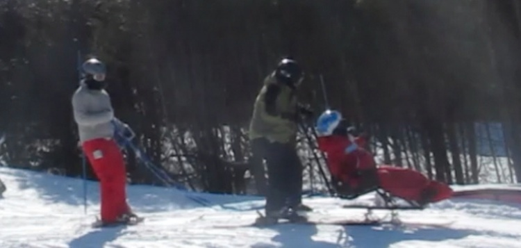 Skiing earlier this winter at  our nearby ski hill where we  have been developing our sit skiing skills.