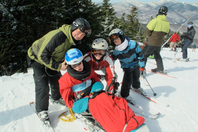 The family at the top of the mountain. Skiing is a winter activity we can all do together.
