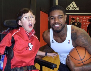 A young Deane with Raptor player Amir Johnson. He remains a huge fan.